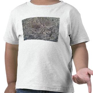 Textura de la superficie mojada de la arena despué camiseta
