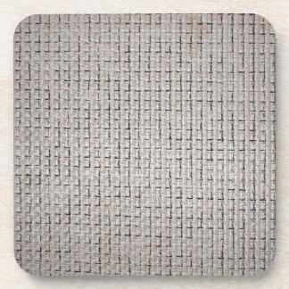 Textura de la tela gris de los filamentos gruesos posavasos de bebida