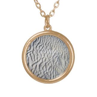 Textura de las ondas de arena joyería