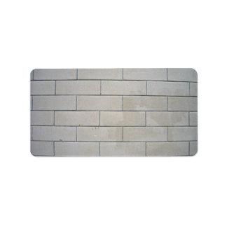 Textura de los bloques de cemento etiquetas de dirección