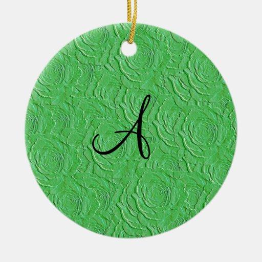 Textura de los rosas verdes claros del monograma adorno redondo de cerámica