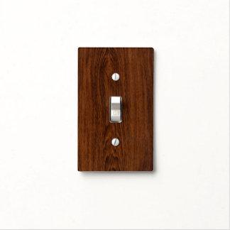 Textura de madera color de rosa oscura del grano placa para interruptor