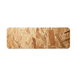 Textura de madera comprimida reciclada para el fon etiqueta de remitente
