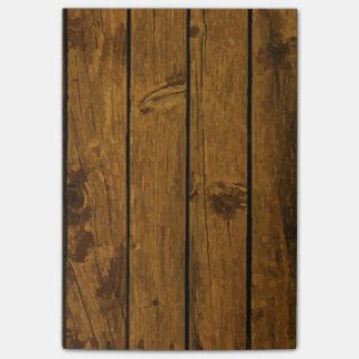 Textura de madera marrón resistida de la pared notas post-it®
