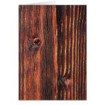 Textura de madera oscura del tablero tarjetón
