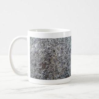 Textura de piedra del fondo del granito taza de café