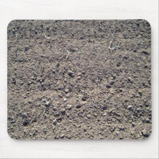 Textura de tierra de la arena con las pequeñas pie alfombrillas de raton