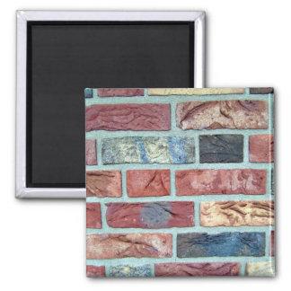 Textura de una pared de ladrillo coloreada imán de nevera