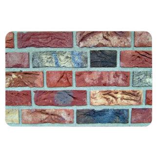 Textura de una pared de ladrillo coloreada iman rectangular
