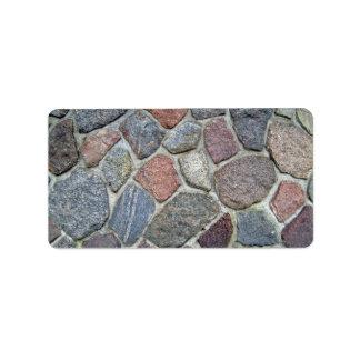 Textura decorativa del fondo de la pared de piedra etiquetas de dirección