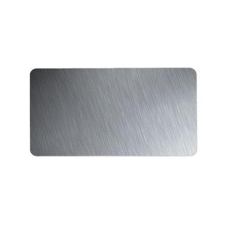 Textura del acero inoxidable con puntos etiqueta de dirección