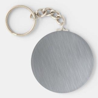 Textura del acero inoxidable con puntos llavero redondo tipo pin