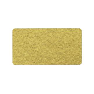 Textura del fondo de la hoja de oro etiqueta de dirección