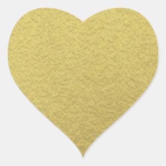 Textura del fondo de la hoja de oro pegatina en forma de corazón