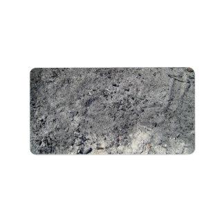 Textura del fondo gris seco de la arena etiquetas de dirección