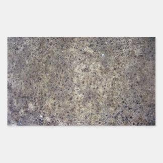 Textura granosa mojada de la arena pegatina rectangular