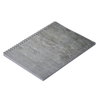 Textura gris áspera del muro de cemento con las lí libro de apuntes con espiral