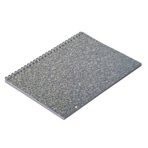 Textura gris de la tela libros de apuntes con espiral