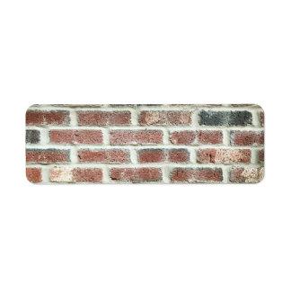 Textura gris del ladrillo del fondo de la pared de etiqueta de remite
