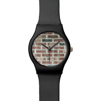 Textura gris del ladrillo del fondo de la pared de relojes