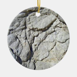 Textura gris natural de piedra rocosa de la adorno redondo de cerámica