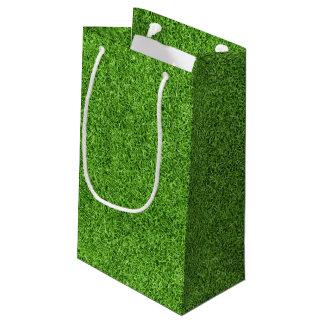 Textura hermosa de la hierba verde del campo de bolsa de regalo pequeña