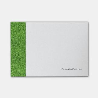 Textura hermosa de la hierba verde del campo de go post-it notas