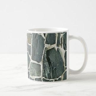 Textura irregular de la pared de piedras tazas