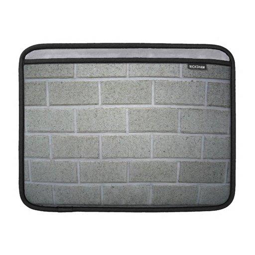 Textura lisa de la pared con los ladrillos blancos funda macbook air