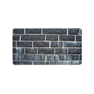 Textura negra de la pared de ladrillo etiquetas de dirección