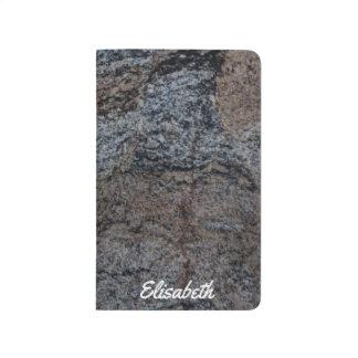 Textura negra roja de piedra del granito cuadernos grapados