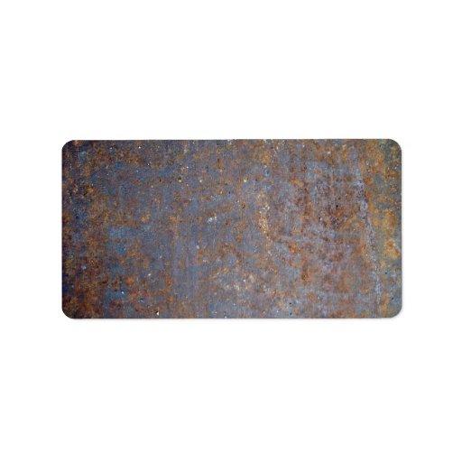 Textura oxidada del metal etiqueta de dirección
