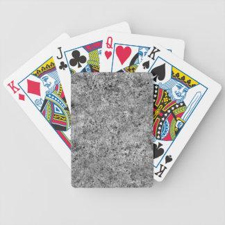 Textura quemada del embaldosado de la arena barajas de cartas