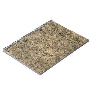 Textura quemada del embaldosado de la arena note book