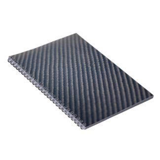 Textura real de la foto de la fibra de carbono libros de apuntes con espiral