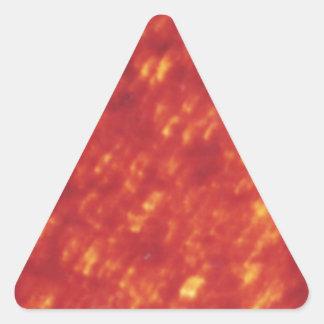 Textura reluciente roja de la lava pegatina triangular