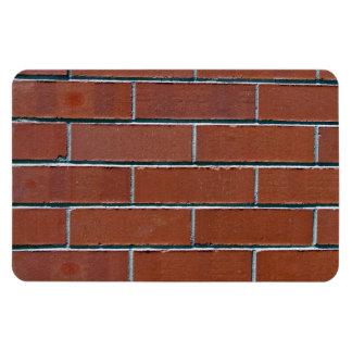 Textura roja inconsútil de la pared de ladrillo es imán flexible