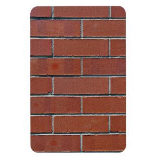 Textura roja inconsútil de la pared de ladrillo es imanes