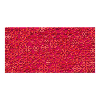 Textura rojiza de los copos de nieve tarjeta fotografica