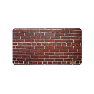 Textura rojo oscuro del fondo de la pared de ladri etiquetas de dirección