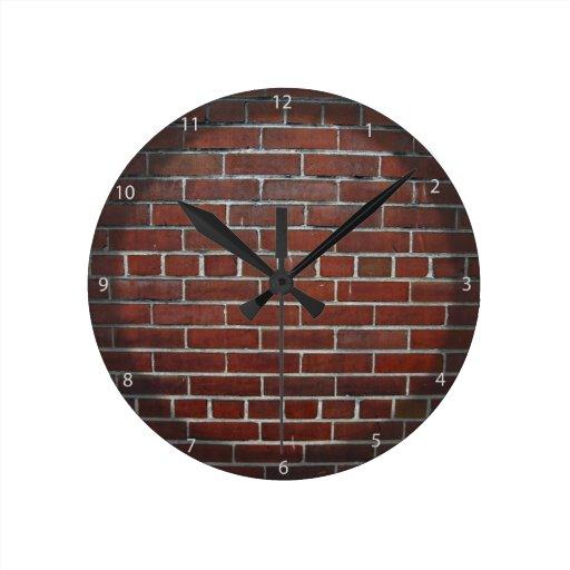 Textura rojo oscuro del fondo de la pared de ladri relojes de pared