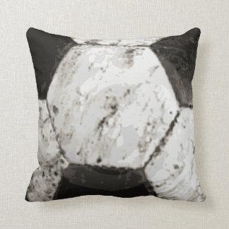 Textura sucia del balón de fútbol cojín