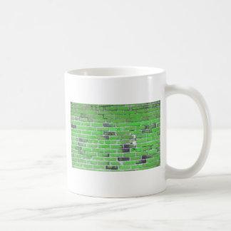 Textura verde de la pared de ladrillo del vintage taza