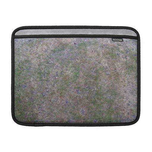 Texturas secas de la tierra de la hierba verde funda macbook air