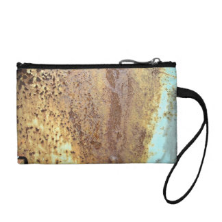 Texture of an rusty metal, painted in blue color coin purse