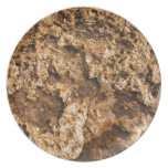Texture of the wet and yellow stone plate