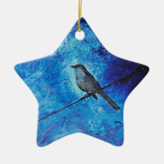 Textured acrylic painting of a blue bird in nature ceramic ornament