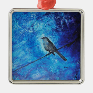 Textured acrylic painting of a blue bird in nature metal ornament