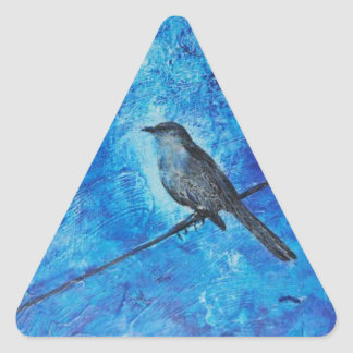 Textured acrylic painting of a blue bird in nature triangle sticker