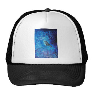 Textured acrylic painting of a blue bird in nature trucker hat